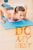A Composite image of determined beautiful woman doing push ups Royalty Free Stock Photo
