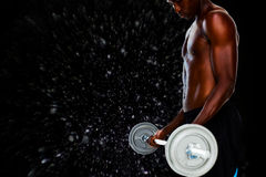 Composite image of determined fit shirtless young man lifting barbell Royalty Free Stock Photos