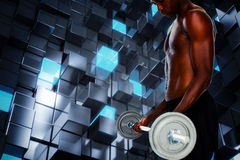 Composite image of determined fit shirtless young man lifting barbell Royalty Free Stock Image
