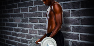 Composite image of determined fit shirtless young man lifting barbell Royalty Free Stock Images