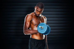 Composite image of determined fit shirtless young man lifting dumbbell Stock Photos