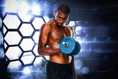 Composite image of determined fit shirtless young man lifting dumbbell Royalty Free Stock Photos
