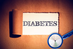 Composite image of diabetes. Diabetes against directly above shot of torn brown paper Royalty Free Stock Image