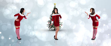 Composite image of different pretty girls in santa outfit Royalty Free Stock Photography
