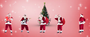 Composite image of different santas Royalty Free Stock Photos