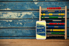 Composite image of digital composite image of back to school text on blue spray paint Royalty Free Stock Image