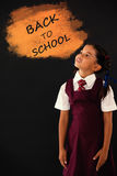 Composite image of digital composite image of back to school text on blue spray paint royalty free illustration