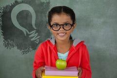 Composite image of digital composite image of light bulb on blue spray paint royalty free illustration