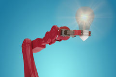 Composite image of digital composite image of red robotic arm holding filament 3d Stock Image