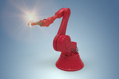 Composite image of digital composite image of red robotic arm holding light bulb 3d Stock Photo