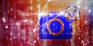 Composite image of digital 3d camera with tick symbol. Digital 3D camera with tick symbol against glowing blue background Royalty Free Stock Photography