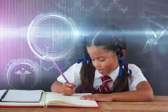 Composite image of digital composite image of dna helix. Digital composite image of DNA helix against schoolgirl doing her homework against chalkboard Royalty Free Stock Images