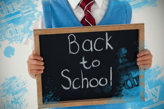 Composite image of digital composite image of equations. Digital composite image of equations against schoolboy holding writing slate with text back to school Royalty Free Stock Images