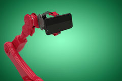 Composite image of digital generated image of red robot holding smart phone 3d Stock Image