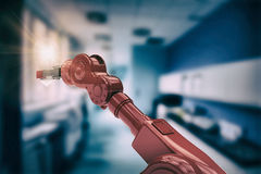 Composite image of digital generated image of red robotic arm holding light bulb 3d. Digital generated image of red robotic arm holding light bulb against Stock Images