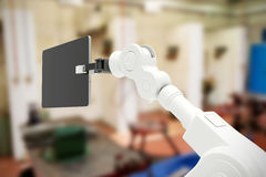 Composite image of digital generated image of robot holding digital tablet 3d Royalty Free Stock Photo