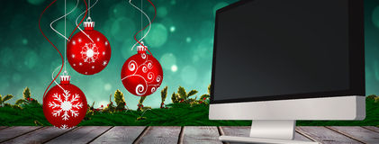 Composite image of digital hanging christmas bauble decoration Stock Photos
