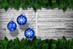 Composite image of digital hanging christmas bauble decoration. Digital hanging christmas bauble decoration against fir tree branches forming frame Royalty Free Stock Photography