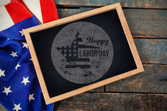Composite image of digital composite image of happy labor day text on blue poster Royalty Free Stock Photos