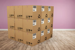 Composite image of digital image of cardboard boxes. Digital image of cardboard boxes against room with wooden floor Royalty Free Stock Image