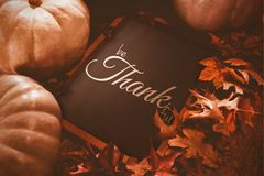 Composite image of digital image of happy thanksgiving day text greeting. Digital image of happy thanksgiving day text greeting against black board surrounded of Stock Photos