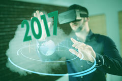 Composite image of digital image of new year 2017. Digital image of new year 2017 against man wearing virtual glass Stock Photography