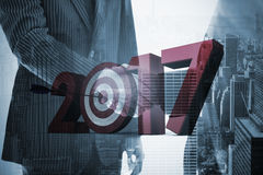 Composite image of digital image of numbers with bulls eye arrow Royalty Free Stock Photography