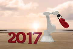 Composite image of digital image of robotic hand holding red number 3d Stock Images