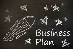 Composite image of digital image of rocket and star shapes with business plan text. Digital image of rocket and star shapes with business plan text against black Stock Photo