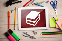 Composite image of digital tablet on students desk Royalty Free Stock Photo