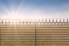 Composite image of digitallly generated image of barbed wire on fence Royalty Free Stock Photography