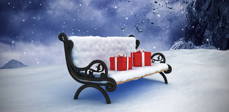 Composite image of digitally composite image of gift boxes on park bench Stock Photos