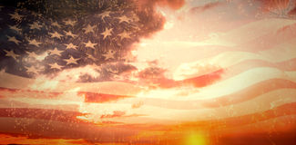 Composite image of digitally generated american flag rippling. Digitally generated american flag rippling against colourful fireworks exploding on black Royalty Free Stock Image