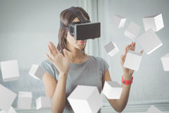 Composite image of digitally generated grey cubes floating. Digitally generated grey cubes floating  against business woman using 3d glasses Royalty Free Stock Image