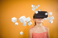 Composite image of digitally generated grey cubes floating. Digitally generated grey cubes floating against girl using a virtual reality device royalty free stock photography