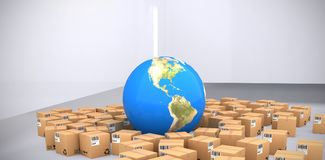 Composite image of digitally generated image of boxes and blue globe. Digitally generated image of boxes and blue globe against abstract room Stock Photo