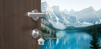 Composite image of digitally generated image of brown door with house key. Digitally generated image of brown door with house key against snowcapped and lake on Stock Images