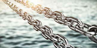 Composite image of digitally generated image of 3d silver metallic chains Stock Photo