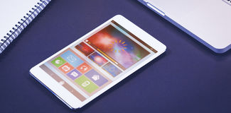 Composite image of digitally generated image of device screen. Digitally generated image of device screen against composite image of digital screen, laptop and Royalty Free Stock Images