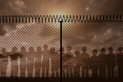 Composite image of digitally generated image of fence with spiral barbed wire Stock Photos