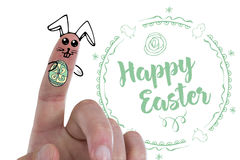 Composite image of digitally generated image of fingers painted as easter bunny. Digitally generated image of fingers painted as Easter bunny against easter royalty free stock image