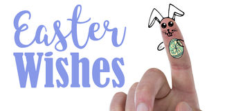 Composite image of digitally generated image of fingers painted as easter bunny. Digitally generated image of fingers painted as Easter bunny against easter stock images
