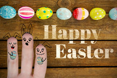 Composite image of digitally generated image of fingers representing easter bunny. Digitally generated image of fingers representing Easter bunny against painted stock image