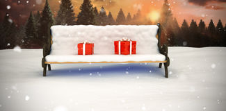 Composite image of digitally generated image of gift boxes on park bench Stock Images