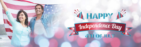 Composite image of digitally generated image of happy independence day message. Digitally generated image of happy independence day message against mature couple Royalty Free Stock Images