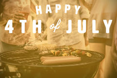 Composite image of digitally generated image of happy 4th of july text. Digitally generated image of happy 4th of july text against family having a barbecue royalty free illustration