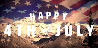 Composite image of digitally generated image of happy 4th of july text. Digitally generated image of happy 4th of july text against scenic view of snowy mountain Stock Photo
