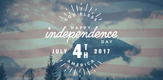 Composite image of digitally generated image of happy 4th of july text. Digitally generated image of happy 4th of july text against snowy mountain range against Stock Photo