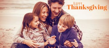 Composite image of digitally generated image of happy thanksgiving text. Digitally generated image of happy thanksgiving text against cheerful parents with Royalty Free Stock Photography