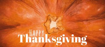 Composite image of digitally generated image of happy thanksgiving text. Digitally generated image of happy thanksgiving text against close up of pumpkin Stock Images